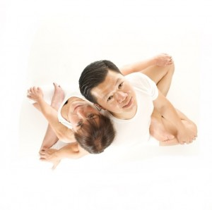 Partner Yoga lotus Twist pose- Adam Quang and Terry Tator
