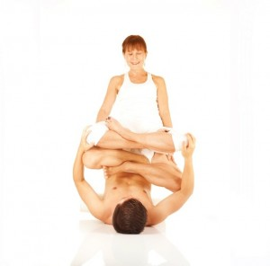 Partner Yoga lotus pose- Adam Quang and Terry Tator -Photo by Max B. Telzerow